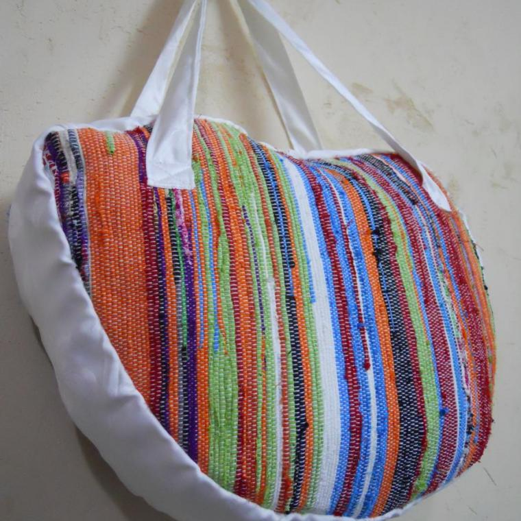Hand woven bag with up cycled fabric material