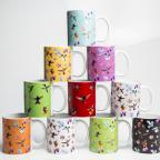 A collection of coffee mugs featuring the Hummingbirds of Trinidad and Tobago