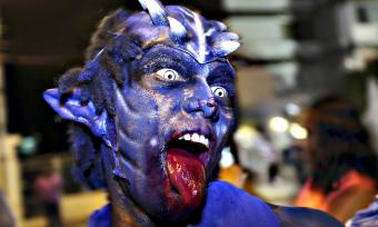 Photo of a man dressed as a blue devil